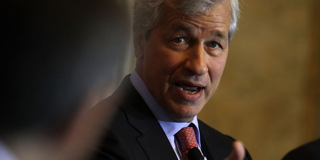 """WASHINGTON, DC - DECEMBER 01:  JPMorgan Chase Chairman and CEO Jamie Dimon participates in a panel discussion during the Financial Inclusion Forum December 1, 2015 at the Treasury Department in Washington, DC. Department of the Treasury and the U.S. Agency for International Development (USAID) held the forum to discuss """"ways to foster greater access to safe and affordable financial services for everyone.""""  (Photo by Alex Wong/Getty Images)"""