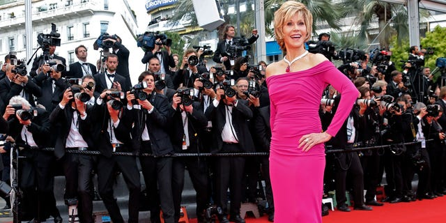 """Actress Jane Fonda poses on the red carpet as she arrives for the screening of the film """"Inside Llewyn Davis"""" in competition during the 66th Cannes Film Festival in Cannes May 19, 2013.        REUTERS/Jean-Paul Pelissier (FRANCE  - Tags: ENTERTAINMENT)   - RTXZT5Q"""