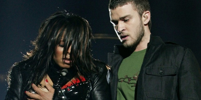 Singer Janet Jackson performs with singer Justin Timberlake during the halftime show at Super Bowl XXXVIII in Houston, Texas, in this February 1, 2004 file photo.