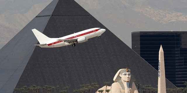Inconspicuous: Janet planes are painted white with a horizontal red band along the side, and reportedly transport military employees and contractors to restricted sites, including Area 51.