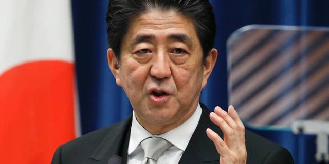 FILE - In this Wednesday, Dec. 24, 2014 file photo, Japan's Prime Minister Shinzo Abe speaks during a press conference at his official residence in Tokyo after taking office for a third term as prime minister.  Japan's Cabinet approved a record 96.3 trillion yen ($814 billion) government budget for the coming fiscal year Wednesday, Jan. 14, 2015. (AP Photo/Shizuo Kambayashi, File)