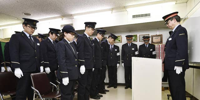 In this 2015 photo, Tokyo subway workers offered silent prayer 20 years after the poison gas attack.