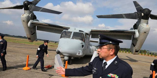Japan Self-Defense Forces stand guard an MV-22 Osprey during the annual Self-Defense Forces Commencement of Air Review.