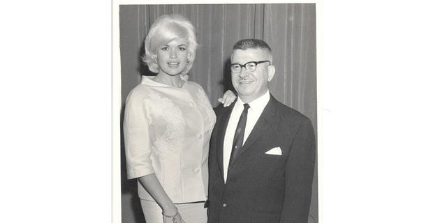 Jayne Mansfield posing with Elaine Stevens' father.