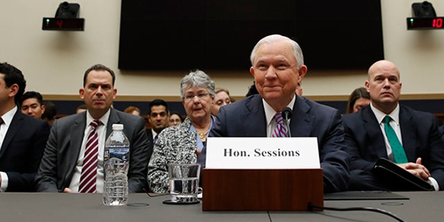 Attorney General Jeff Sessions listens at the beginning of a hearing before the House Judiciary Committee on Capitol Hill, Tuesday, Nov. 14, 2017 in Washington. (AP Photo/Alex Brandon)