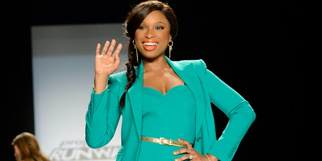 Actress/singer Jennifer Hudson poses for photographers prior to the start of the Project Runway show during New York Fashion Week.