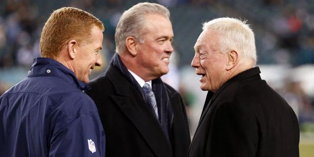Dec 14, 2014; Philadelphia, PA, USA; Dallas Cowboys head coach Jason Garrett (left) and owner Jerry Jones (right) talk during warm ups before a game against the Philadelphia Eagles at Lincoln Financial Field. Mandatory Credit: Bill Streicher-USA TODAY Sports