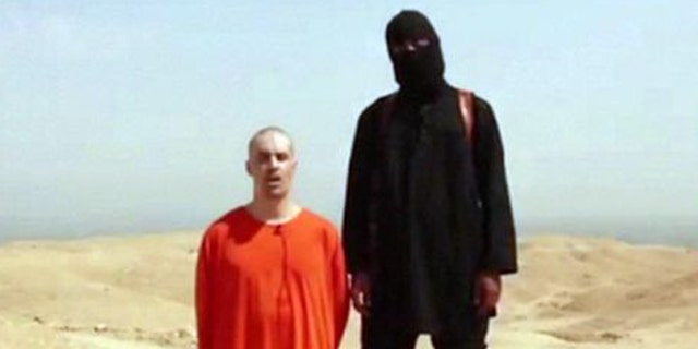 """This still from a video released by ISIS shows slain American James Foley with a man believed to be Mohammed Emwazi, formerly known by the alias, """"Jihadi John."""""""