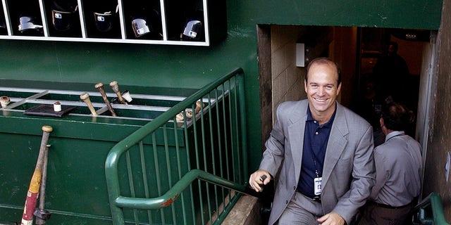 Jim Duquette walks out to the baseball field. (AP Photo/Mark J. Terrill)
