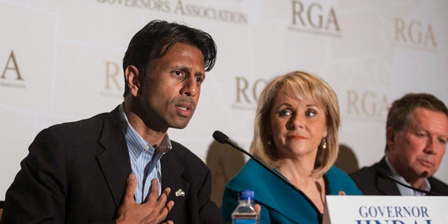 FILE 2013: Governor Bobby Jindal  answers a question during a media briefing at the Republican Governors Association conference in Scottsdale, Arizona.