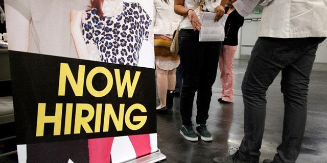 June 13, 2012: A job seeker talks to a recruiter at a job fair expo in Anaheim, Calif.