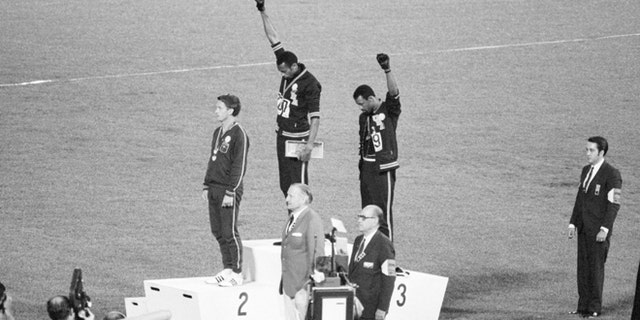 Americans Tommie Smith and John Carlos raised black-gloved fists in the black power salute in protest during the national anthem at the 1968 Mexico Games.