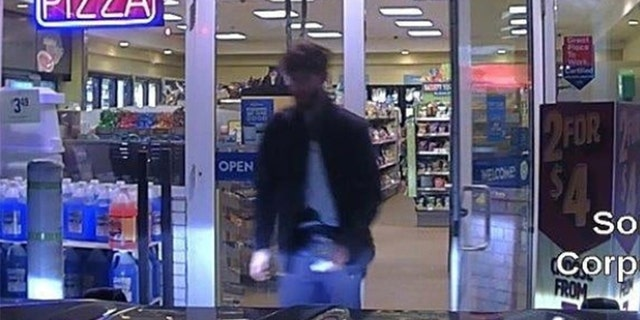 John Williams, 29, is seen leaving a convenience store early Wednesday, after  police say he killed Corporal Eugene Cole.