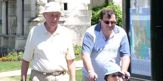 Robert Oliver is pictured here with his father, John, and mother, Betty, who died in 2012.