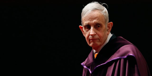 """U.S. mathematician and Nobel Laureate John Nash, 83, stands on the podium as he receives an Honorary Doctor of Science at the City University of Hong Kong November 8, 2011. Nash came up with the concept of """"Nash Equilibrium"""", used in game theory.  REUTERS/Bobby Yip (CHINA - Tags: EDUCATION SOCIETY) - RTR2TQNX"""