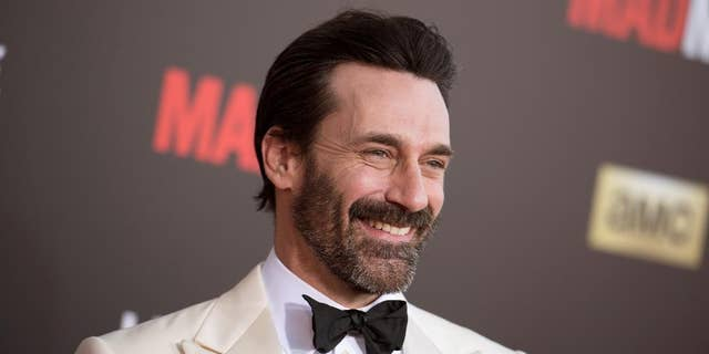 """FILE - In this March 25, 2015 file photo, Jon Hamm arrives at The Black And Red Ball In Celebration Of The Final Seven Episodes Of """"Mad Men"""" in Los Angeles. Court records show """"Mad Men"""" star Jon Hamm was accused of helping lead a violent 1990 fraternity hazing at the University of Texas. (AP Photo/Photo by Richard Shotwell/Invision/AP, File)"""