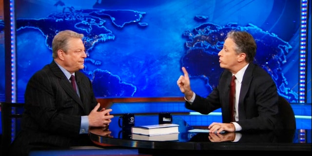 """Al Gore, left, sits down with Jon Stewart to discuss Current TV and Al Jazeera on """"The Daily Show."""""""