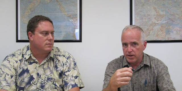 May 10, 2012: John Van Dame, right, U.S. Pacific Fleet senior environmental planner, and Roy Sokolowski, a U.S. Pacific Fleet sonar modeling expert, speak in Honolulu about the Navy's new environmental impact statement for training and testing in Hawaii and California waters.