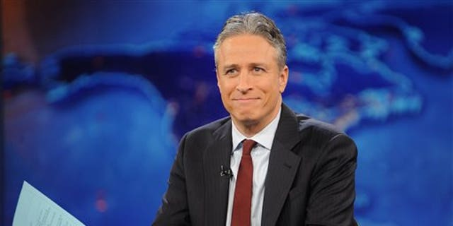 """FILE - This Nov. 30, 2011, file photo shows television host Jon Stewart during a taping of """"The Daily Show with Jon Stewart"""" in New York. (AP Photo/Brad Barket, File)"""