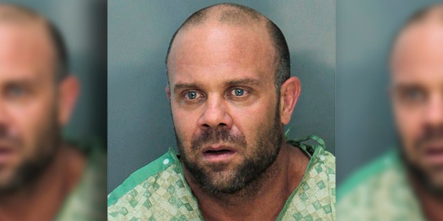 Police say Jonathan Oddi stormed the lobby of the Trump National Doral Golf Club early Friday, May 18, carrying an American flag and shouting about the president. According to police, he fired at a chandelier before exchanging gunfire with officers, who shot him in the legs and took him into custody. (Miami Dade Department of Corrections via AP)