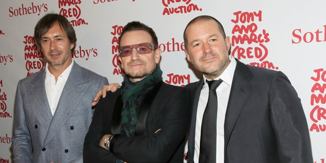 File photo - Designer Marc Newson (L), Singer Bono (C) and Apple's Jony Ive attend Jony And Marc's (RED) Auction at Sotheby's in New York Nov. 23, 2013.
