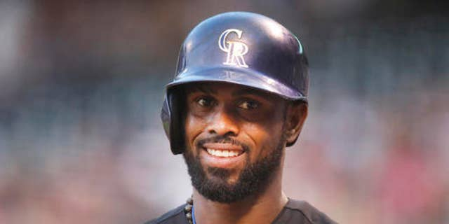 FILE - In this Aug. 21, 2015, file photo, Colorado Rockies shortstop Jose Reyes is seen in the first inning of a baseball game in Denver. Colorados Jose Reyes has been suspended by Major League Baseball through May 31 for violating MLBs domestic violence policy. The unpaid suspension of Reyes is retroactive to February 23, 2016, when Reyes was placed on leave pending the resolution of criminal proceedings in Hawaii. Reyes has agreed not to appeal the discipline. (AP Photo/David Zalubowski, File)