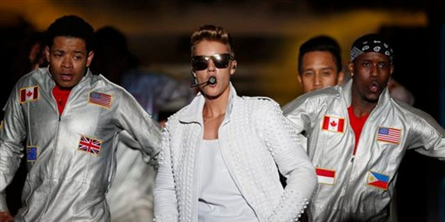 Canada's pop star Justin Bieber performs in concert during his Believe world tour in Asuncion, Paraguay.