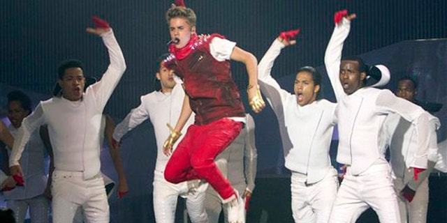 """FILE - This June 17, 2012 file photo shows singer Justin Bieber performing during the 2012 Much Music Video Awards in Toronto. Bieber's """"Believe"""" is the year's top-selling debut. Nielsen SoundScan reports sales of 374,000 copies following its release last week, giving the 18-year-old Canadian pop singer the fourth No. 1 album and the best sales week of his young career. """"Believe"""" also debuted at No. 1 in 29 other countries. (AP Photo/The Canadian Press, Chris Young, file)"""
