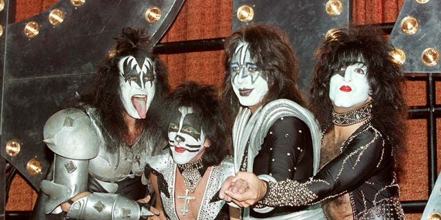 """September 22, 1998. The band KISS pose during a press conference to promote their new album, """"Psycho Circus"""" at Mann's Chinese Theater in Hollywood. From L to R, Gene Simmons, Peter Criss, Ace Frehley and Paul Stanley."""