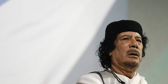 FILE: Libyan leader Muammar al-Qaddafi gives a speech in Rome August 30, 2010.