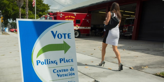 MIAMI, FL - MARCH 15: A woman arrives to vote at a fire station on March 15, 2016 in Miami, Florida. Voters cast ballots in the presidential primary in Illinois, Missouri, North Carolina, Ohio and Florida today. (Photo by Angel Valentin/Getty Images)