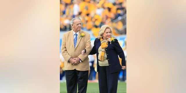 Former West Virginia head coach Bobby Bowden, left, with his wife Ann attend a ceremony where he was awarded the WVU Outstanding Alumni Award during halftime of an NCAA college football game in Morgantown, W.Va., Saturday, Oct. 4, 2014. (AP Photo/Chris Jackson)