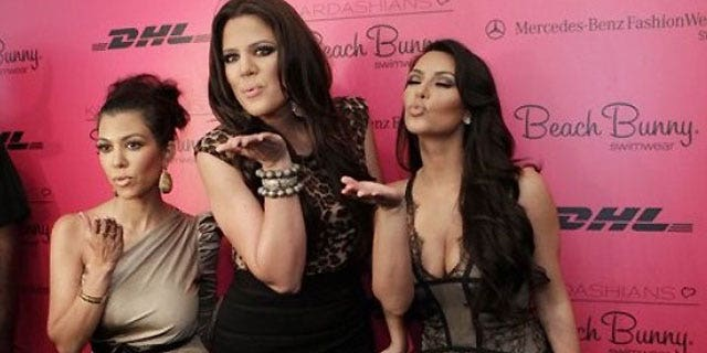 The Kardashian sisters Kourtney, Khloe and Kim.
