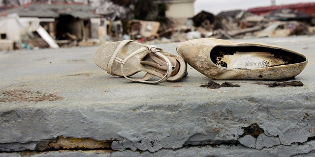 File photo - A pair of shoes sits on what is left of the front porch of a home in the lower Ninth Ward of New Orleans Feb.19, 2006.
