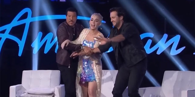 """Lionel Richie and Luke Bryan held Katy Perry back from ambushing a male """"American Idol"""" contestant."""