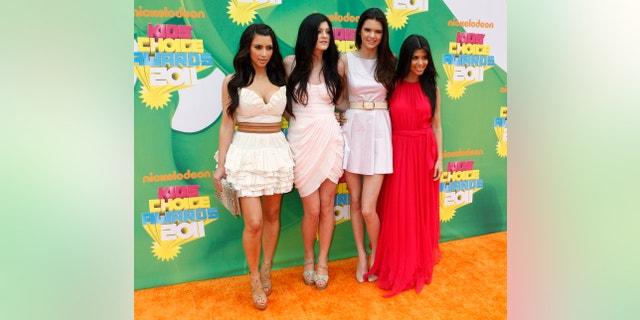 Family members Kim Kardashian, Kylie Jenner, Kendall Jenner and Kourtney Kardashian pose at the 2011 Nickelodeon Kids Choice Awards in Los Angeles, California April 2, 2011.