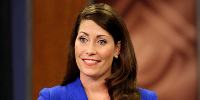 """Kentucky Secretary of State Alison Lundergan Grimes, before her appearance on """"Kentucky Tonight"""" television broadcast with U.S. Senate Minority Leader Mitch McConnell (R) Ky., live from KET studios in Lexington, Ky., on Monday, Oct. 13, 2014. (AP Photo/The Lexington Herald-Leader, Pablo Alcala, Pool)"""