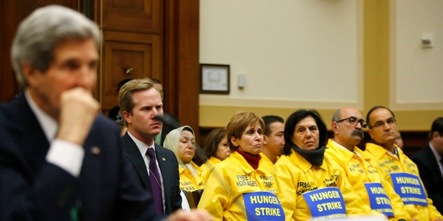 FILE: Dec. 10, 2013: Families of Iranian dissidents and Secretary of State John Kerry on Capitol Hill about Iran's nuclear programs, Washington, D.C.