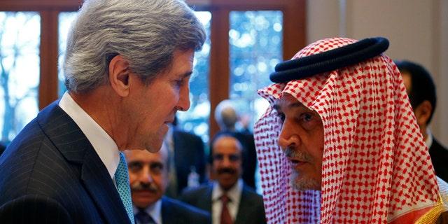 Jan. 22, 2014: Secretary of State John Kerry talks to Saudi Arabia's Foreign Minister Prince Saud al-Faisal in Montreux, Switzerland.
