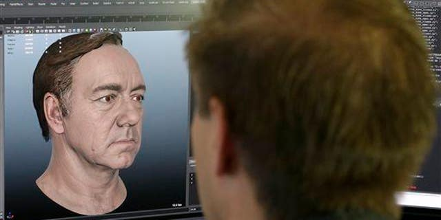 """This July 31, 2014, photo shows a senior technical artist working on the face of actor Kevin Spacey for the new """"Call of Duty: Advanced Warfare"""" game at Sledgehammer Games in Foster City, Calif."""