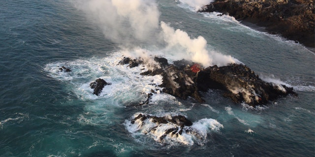 """A """"tiny new island"""" has formed along the coastline of the Kilauea volcano, the U.S. Geological Survey said Friday. Officials believe it's """"part of the fissure 8 flow that's entering the ocean."""""""