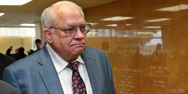 April 21, 2015: Robert Bates arrives for his arraignment at the Tulsa County courthouse in Tulsa, Okla. Bates, a 73-year-old Tulsa County reserve deputy, fatally shot a suspect who was pinned down by officers. (AP Photo/Sue Ogrocki, File)