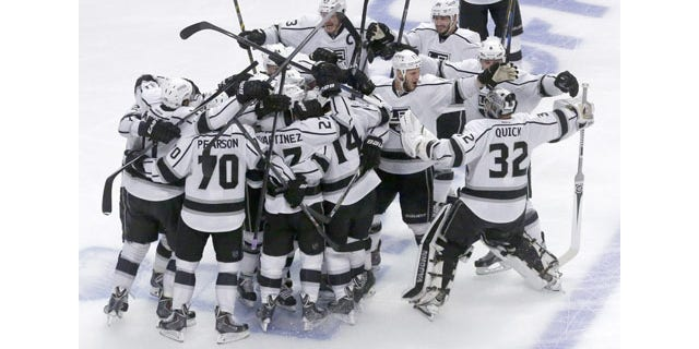 June 1, 2014: The Los Angeles Kings celebrate after defeating Chicago Blackhawks 5-4 in overtime in Game 7 of the NHL Western Conference finals in Chicago. (AP Photo/Charles Rex Arbogast)