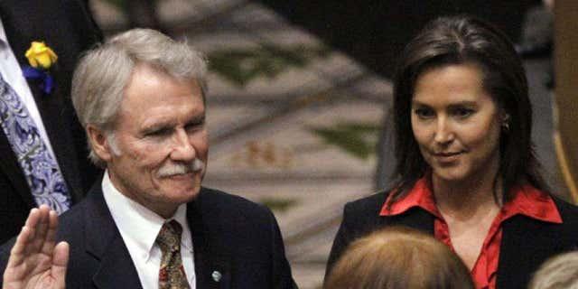 Jan. 10, 2011: Oregon Gov. John Kitzhaber, Democrat, is sworn in with financee Cylvia Hayes at his side. Salem, Oregon.