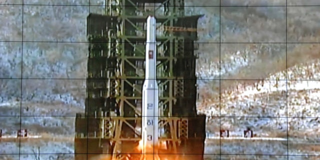 FILE - In this Dec. 12, 2012 file photo, a screen at the General Satellite Control and Command Center in Pyongyang, North Korea shows the moment an Unha-3 rocket is launched. (AP Photo/File)