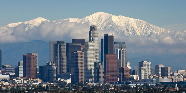 LOS ANGELES, CA - JANUARY 7:  Fresh snow blankets the mountains behind the downtown skyline after a series of storms that hammered northern California delivered much needed precipitation to the Greater Los Angeles Area January 7, 2008 in Los Angeles, California. With the threat of mandatory water rationing still in effect because of prolonged drought, the rain is a small step toward relief. Forecasters had predicted flash floods and mudslides near large areas that were denuded by wildfires of historic proportions in October, and some mandatory evacuations were declared, but little damage was reported.  (Photo by David McNew/Getty Images)