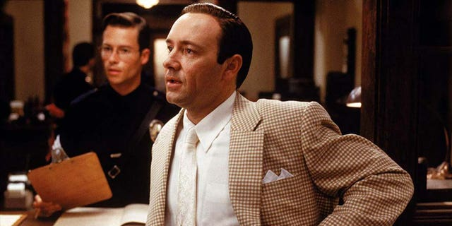 """Guy Pearce [left] said Kevin Spacey [right] was """"a handsy guy"""" when they worked together on the 1997 film """"L.A. Confidential."""""""