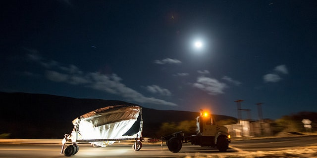 NASA's Low Density Supersonic Decelerator (LDSD) test vehicle is rolled out to the launch pad under moon light, Wednesday, June 3, 2015, at the U.S. Navy Pacific Missile Range Facility (PMRF) in Kauai, Hawaii.