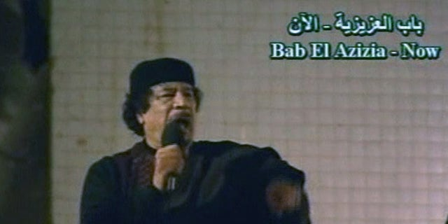 he talks to a large crowd in Bab El Azizia, Libya.