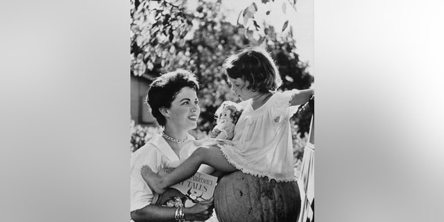 Shirley Temple with her daughter, Lori, in Atherton, California, in 1957.